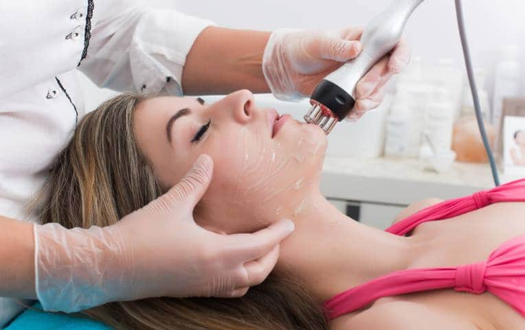 Woman undergoing facial treatment