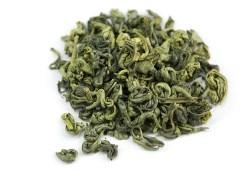 dried green tea leaves on white