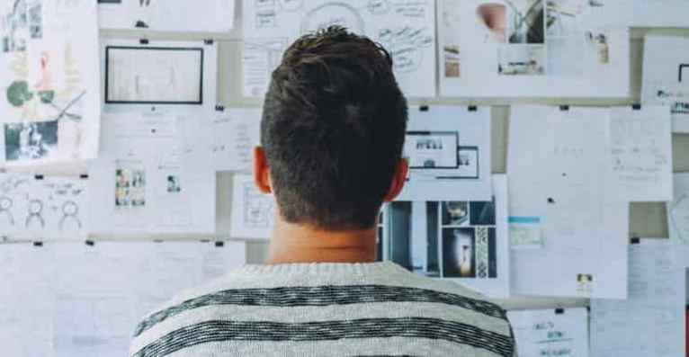 man looking at files
